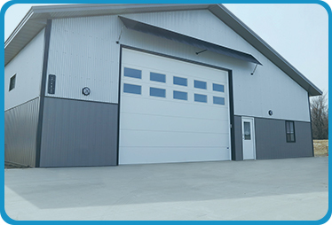 https://alpinegaragedoorstx.com/wp-content/uploads/2021/01/Commercial-Garage-Doors.jpg